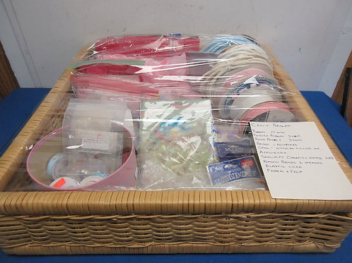 Large square wicker basket filled with craft items, ribbon, beads, gems & more..