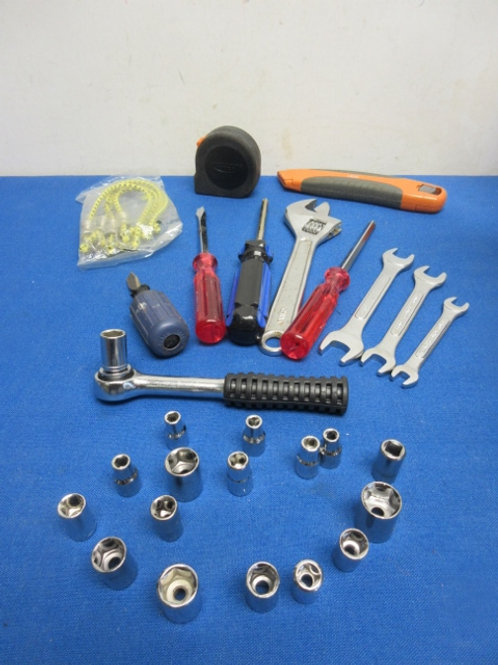 Assorted tool set, small rachet w/ sockets,screw drivers,cresent wrench more...