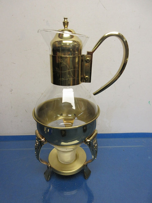 Gold and glass beverage pitcher with candle warming stand