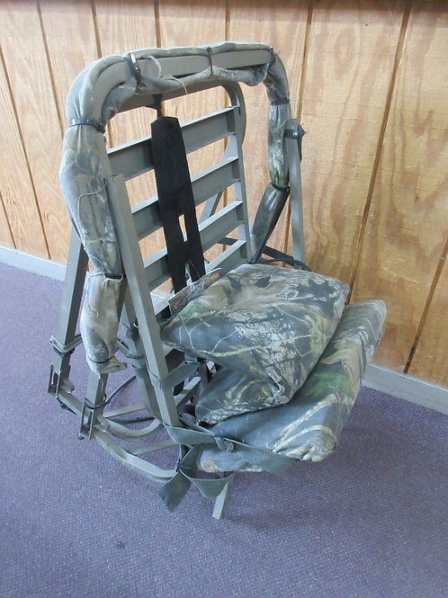 Summit climbing tree stand with adjustable seat and foot rest