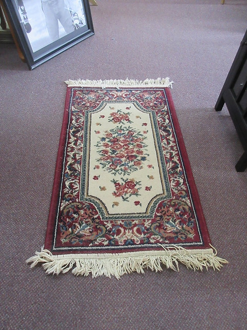 Small fringed oriental style throw rug 24x40""