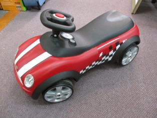 Mini coop style red and black ride on car with beeping horn