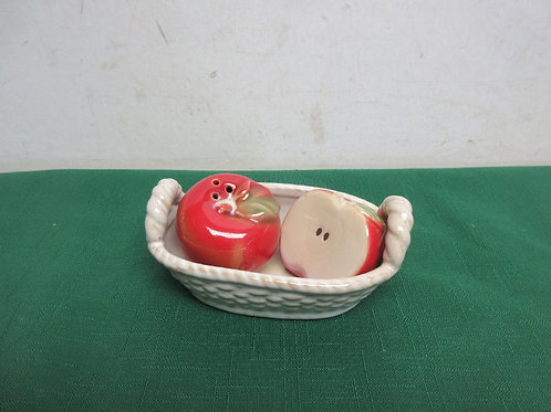 Small apple salt & pepper shakers in an oval ceramic basket
