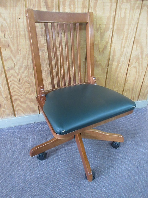 Mission style oak officechair with green vinyl seat