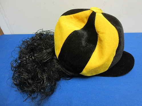 Black & gold hat with long black hair