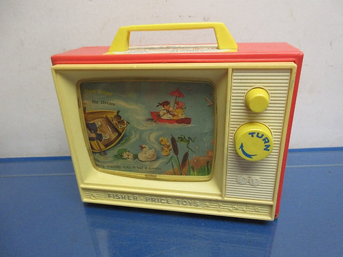 Vintage Fisher Price wind up TV, the back has a crack