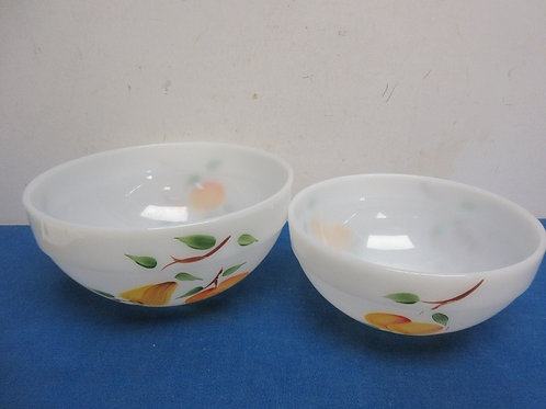 "Pair of white pyrex bowls, 7"" & 9"" diameters"