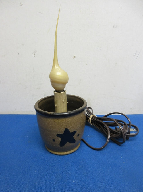 Stoneware cup with electric candle inside