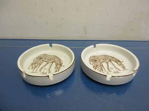 Pair of round ceramic wild habitat ash trays, zebra design