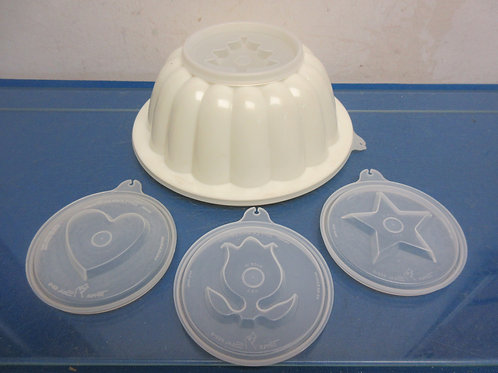 White Tupperware jello mold with 4 changeable tops for mold