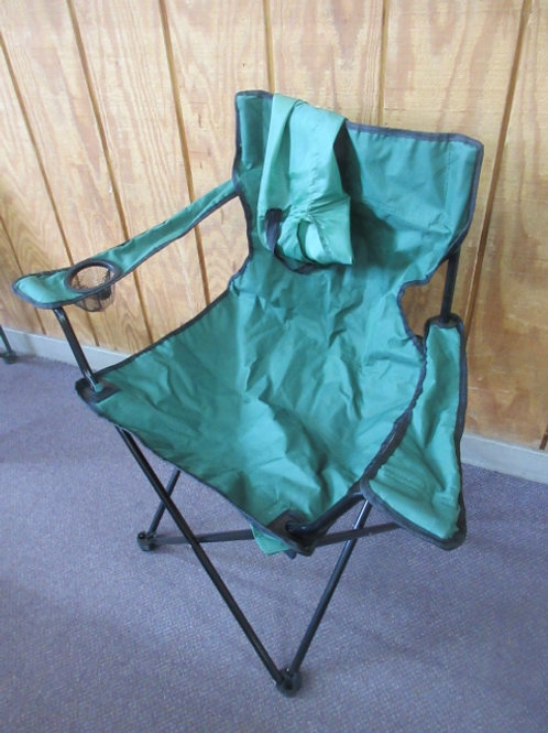 Green folding camp chair with arms