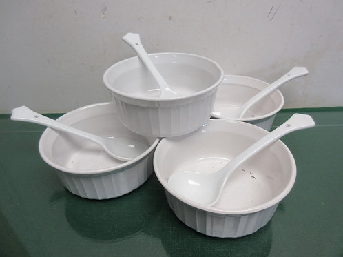 Set of four 18 oz round white corning bowls and 4 ceramic serving spoons