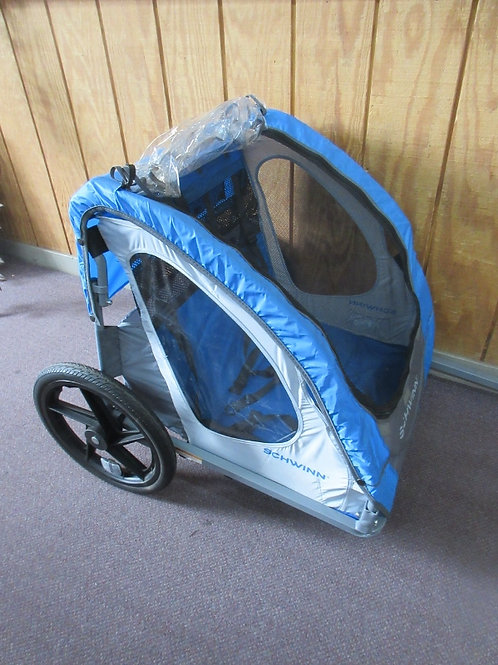 inn pull behind 2 seat child size bike trailer - used once - folds for easy stor