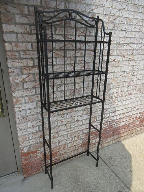 Black metal over the commode shelf unit