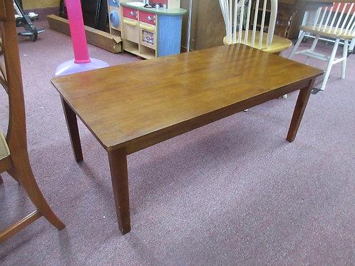 "Cherry tone rectangular coffee table, 24x48x18""high"