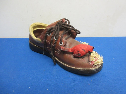 Decorative resin shoe with red bird on the toe