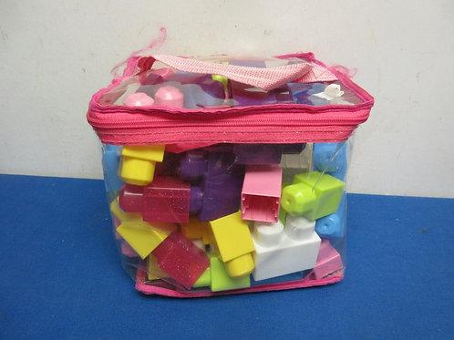 Clear plastic container of mega bloks
