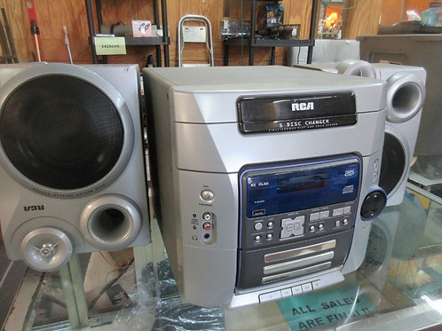RCA 5 disc stereo with 2 speakers - am/fm radio, cd player - tested