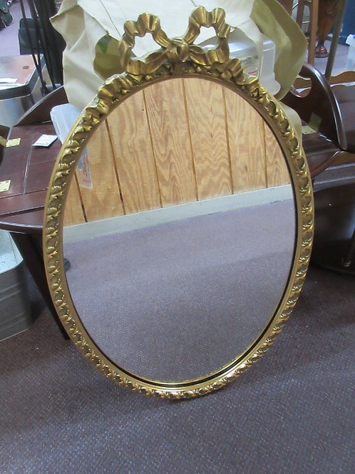 Antique gold oval framed mirror with bow at top 27x16