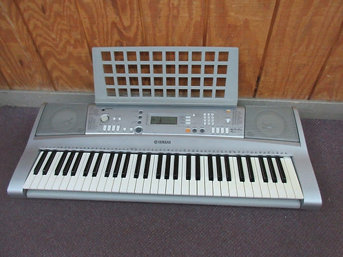 Yamaha electric keyboard, YPT-300, with music book holder