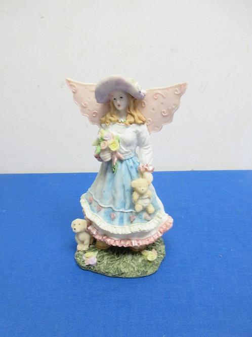 Angel with puppy figurine