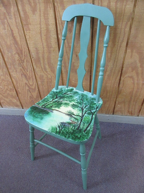 Green painted vintage chair with lake scene painted on seat