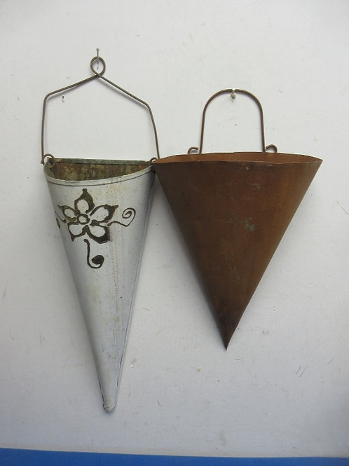 Pair of handmade metal cone wall sconce flower holders, one white, one brown