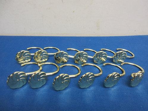 Set of gold shower curtain hooks