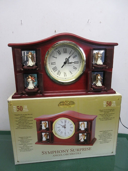 Symphony surprise angel orchestra cherry mantle Clock, musical and animated