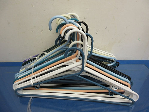 Group of 32 plastic hangers