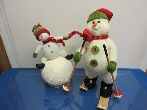 Set of 2 standing snowman - one with skis and one on snowball