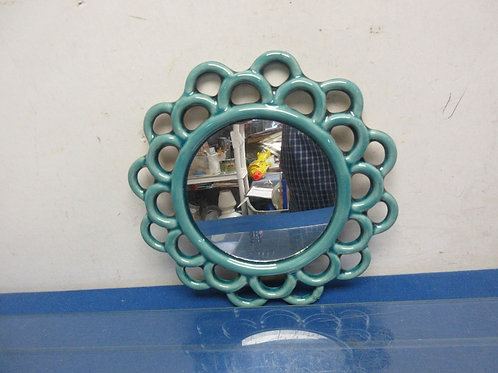 Small round mirror with green ceramic like lace edging