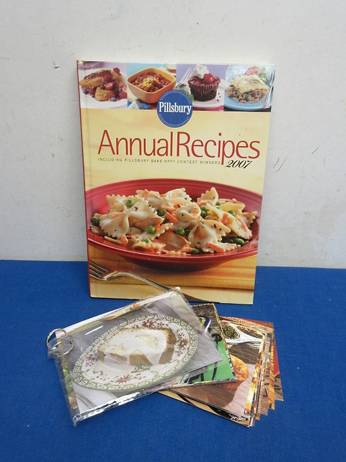 Pillsburty annual recipe cookbook and a pack of assorted recip cards