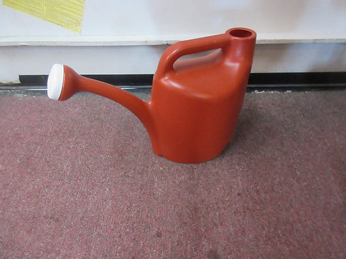 Plastic burnt orange watering can