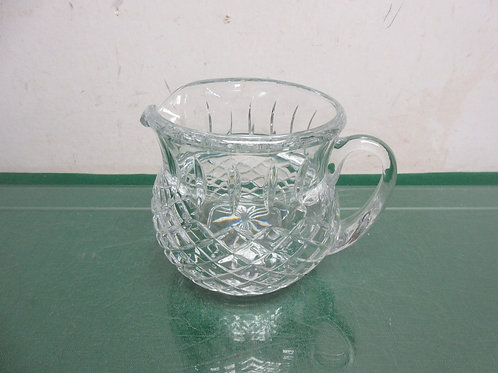 Heavy cut glass wide mouth pitcher