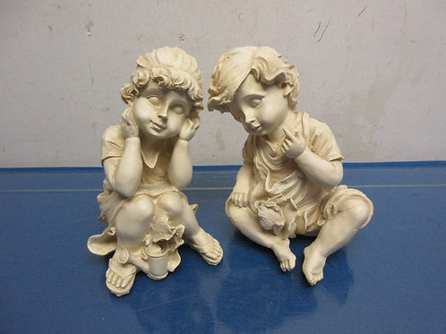 "Pair of resin sitting children statues-boy & girl-each 6""high"