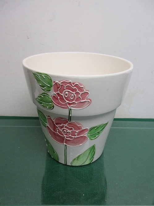 """pot with flower design on the side 9""""dia x 9""""high"""