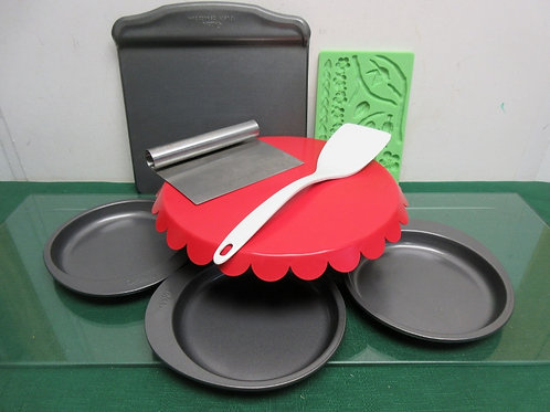 Set of 8 pc bakeware - pedestal cake plate, scraper, several Wilton pans & more