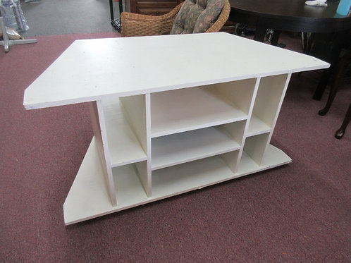 White painted handmade corner TV stand with multi sized cubby storage in base