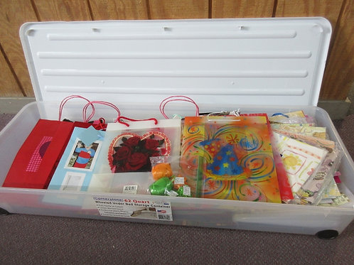 Cornerstone wheeled 62 qt under bed container, filled w/gift bags,wrapping paper
