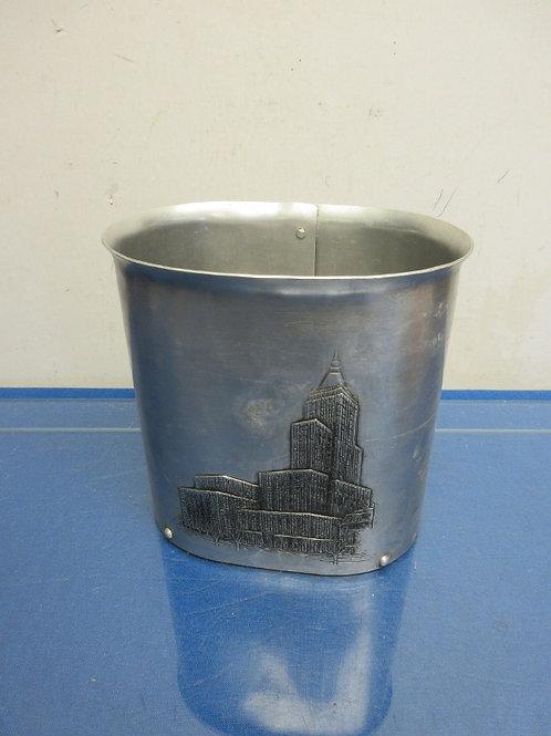 Wendell August Forge handmade oval tall canister w/building on front