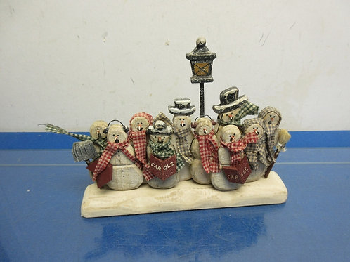 Wooden tabletop group of 10 snowman carrolers