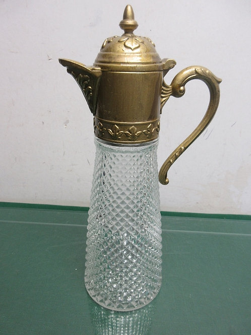 Heavy textured glass decanter with golden topper with handle