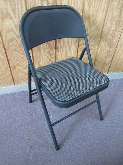 Black metal folding chair with padded seat