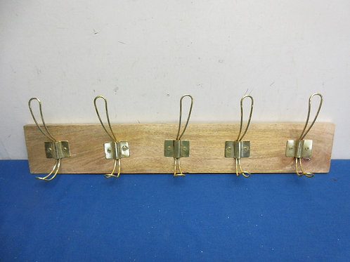 Board with 5 gold coat hooks