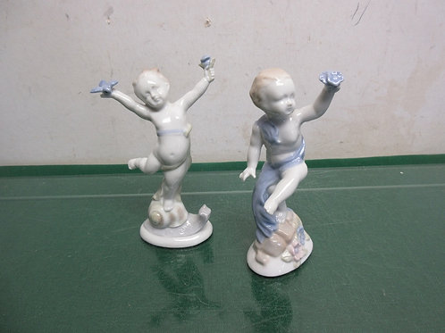 "Pair of 5"" porcelain cherub statues"