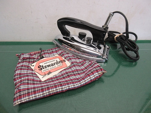 Folding travel iron in carry bag
