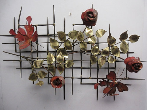 Metal criss cross trellis wall sculpture with roses