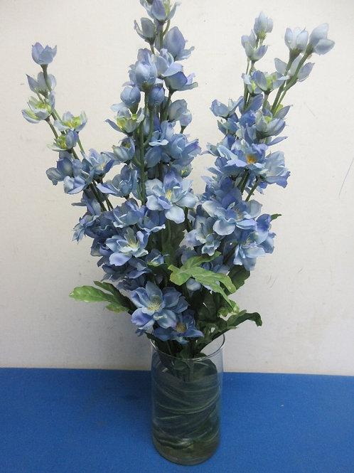 Green swirl design vase with blue flowers