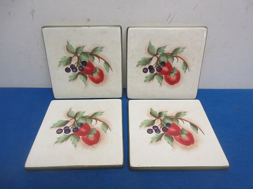 Set of 4 ceramic trivets with fruit designs